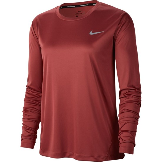 Anunciante Repegar fluido  Kick your run into high gear with the Nike Miler Top. Sweat-wicking fabric  with zoned mesh helps keep you cool as your route heats up. The dropped  back hem and thumbholes offer